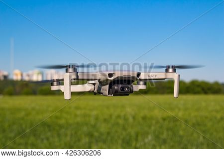 Dji Mini 2 Drone In Flight With Fields And Houses In The Background: Russia - June 2021