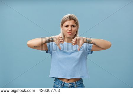 No Way Mate Dislike. Portrait Of Dissatisfied Bossy Female Tattoo Artist With Tattoos On Arms Frowni