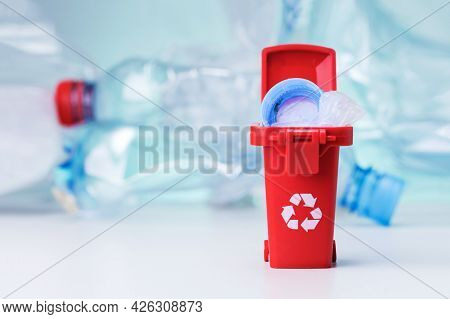 Recycling Trash Can With Plastic Rubbish With Copy Space.  Waste Sorting. Recycle Idea Of Plastic.