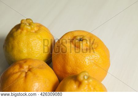 Top View Of Tangerines On The Table With Copy Space. Orange, Sweet And Tropical Citrus Fruit. Fruit