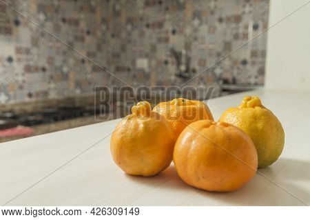 Tangerines On The Brazilian Kitchen Table With Tile In The Background And Copy Space. Orange Citrus