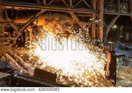 Blast Furnace, Cast Iron Production. Metal Poured Out Of The Metallurgical Furnace, Many Bright Spar