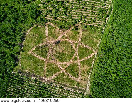 Geoglyph In The Form Of An Atom Symbol, An Outline Where Trees Are Planted, Aerial View. District Of