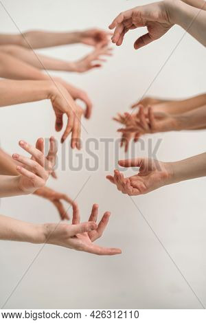 Natural Female Hand Beauty. Many Female Hands Without Manicure. Vertical Frame With Hands. The Trend