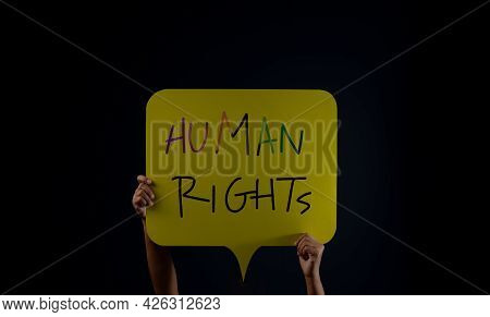 Speech To Freedom. Protest , Mob Or Expression Concept. Person Raised Up A Human Rights Text In The