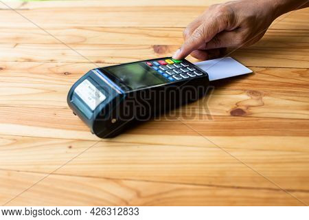 Selective Focus To Hand Put Credit Card In Slot Of Credit Card Reader, Credit Card Payment, Buy And