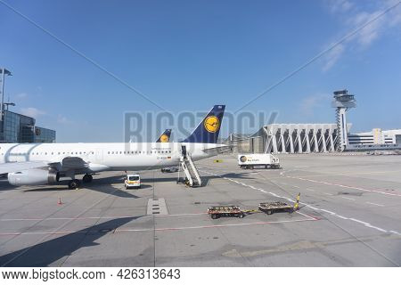 Frankfurt Germany - August 15 2016; Airport Exterior With Parked Planes And Equipment And No People.