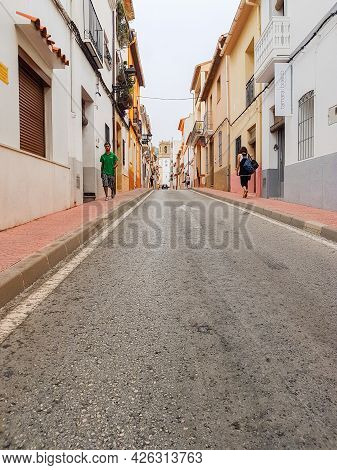 Orba Spain - August 16 2016; Typically Narrow And Picturesque European Village Street Lined By Two L