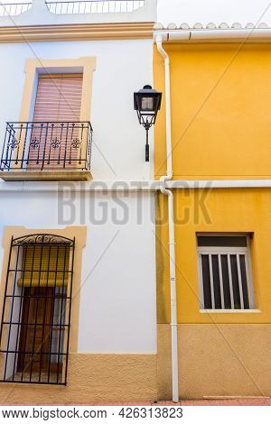 Orba, Village Streets And Building Facade In Yellow And Light Blue, Spain