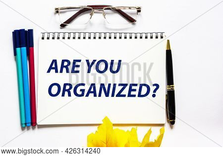 Notepad With Text Are You Organized. White Background With Stationery.