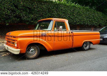Ramsgate, United Kingdom - June 29, 2021: A Mid Sixties Orange 2 Door Ford F100 Pickup Truck