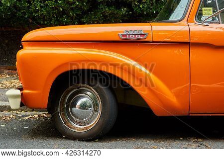Ramsgate, United Kingdom - June 29, 2021: Front Wheel Arch Of A Mid Sixties Orange 2 Door Ford F100