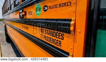 NORWALK, CT, USA - JULY 6, 2021: School bus on Calf Pasture beach side view