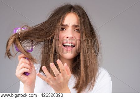 Straightening Woman And Treatment Of The Hair. Girl With Straight Brushed Hair. Hair Tangling Proble