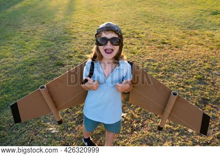 Child Dreams Of Becoming A Rocket Pilot. Imagination And Motivation Concept. Boy Dreams Of Flying. C