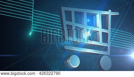 Image of online shopping trolley and green glowing lines over computer circuit board. digital interface connection and communication concept digitally generated image.