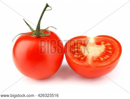 Juicy Red Tomato With Half Is Isolated On A White Background. Full Clipping Path.