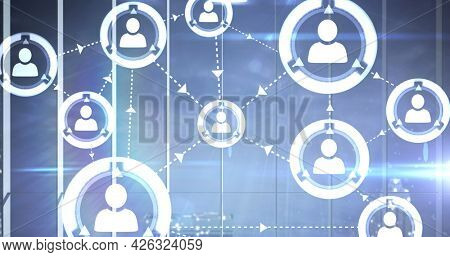Image of network of connection with people icons over cityscape. digital interface connection and communication concept digitally generated image.