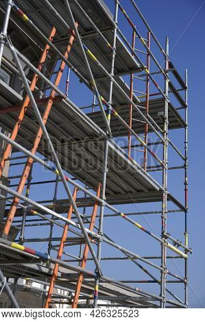 Scaffolding Surrounding House Development For Safe Access To Construction Work