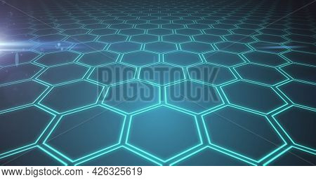 Image of network of interconnected glowing green hexagons. global network of connections technology concept digitally generated image.