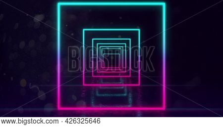 Image of glowing neon turquoise and pink squares outlines moving towards camera in hypnotic motion in repetition on black background. Neon kaleidoscopic motion concept digitally generated image. 4k