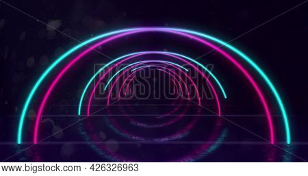 Image of glowing neon turquoise and pink arched lines moving towards camera in hypnotic motion in repetition on black background. Neon kaleidoscopic motion concept digitally generated image. 4k