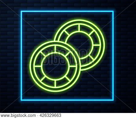 Glowing Neon Line Casino Chips Icon Isolated On Brick Wall Background. Casino Gambling. Vector