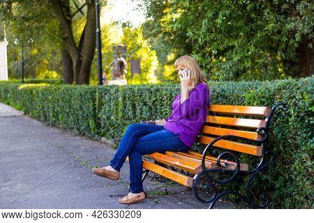 Defocus Elegance Caucasian Blond Woman Talking, Speaking On The Phone Outside, Outdoor. 40s Years Ol