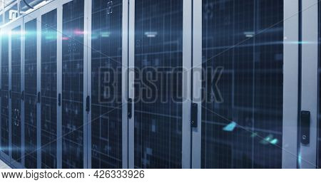 Image of digital data processing flowing through network of computer servers in server room with glowing lights. Global network of data processing centre concept digitally generated image.