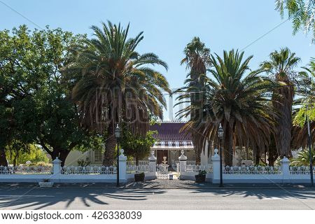 Matjiesfontein, South Africa - April 20, 2021: A Street Scene, With An Historic Building, In Matjies