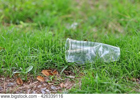 Waste Plastic Glass Is Left On The Grass