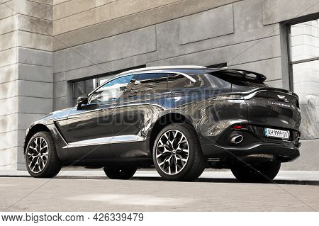 Kiev, Ukraine - May 22, 2021: Aston Martin Dbx Gray Luxury Super Suv Against The Background Of A Gra