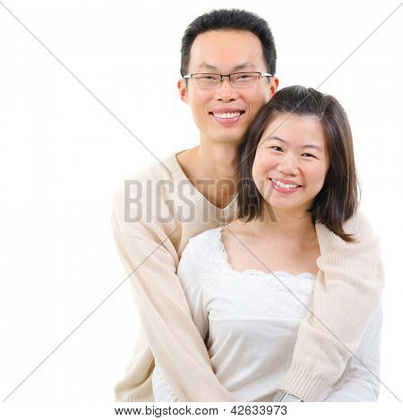 Happy middle aged Asian couple in love. Asian couple smiling isolated on white background.