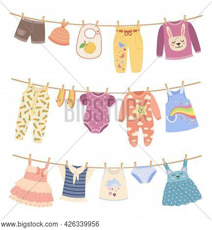 Kids Clothes On Ropes With Clothespin. Cute Child Dress, Shirts, Pants. Children Clothing Hanging On