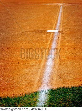 Baseball base and chalked base line in diamond