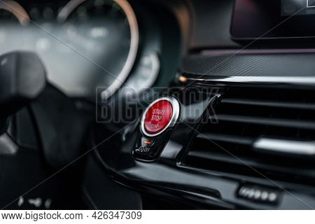 Sports Car Dashboard With Focus On Red Engine Start Stop Button. Button Engine Start And Engine Stop