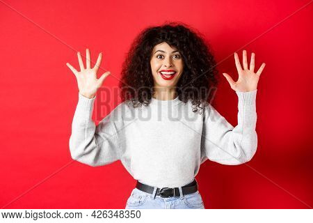 Happy Beautiful Woman Smiling And Raising Hands Up, Showing Number Ten, Ordern Dozen Of Something, S