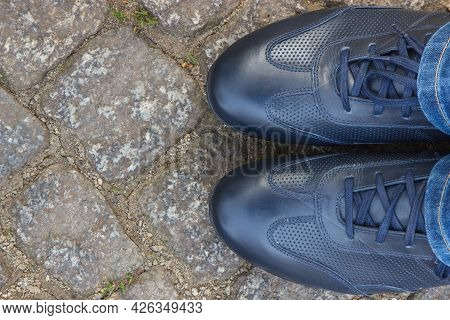 Comfortable Navy Blue Leather Shoes For Men On Footpath Made Of Rocks Or Stones. Male Footwear