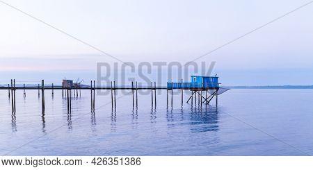 Hut of fishermen in blue sunset in Yves bay, France