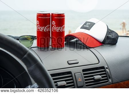 Strelkovoye, Ukraine - 23 June 2021: Illustrative Editorial Of Two Coca Cola Cans Standing On The Ca