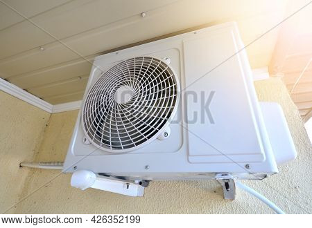 An Outdoor Unit Of Air Conditioner On A Wall