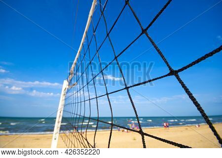 A Volleyball Net On The Beach Against The Sea