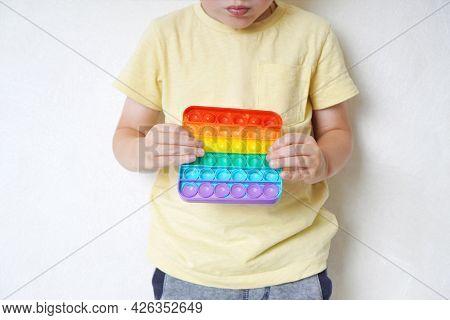 Pop It Bubble Fidget Toy In A Boy's Hands