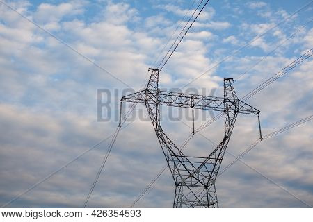 Metal Poles Electric Supports For High-voltage Wires In The Fields In The Summer.high Voltage Poles