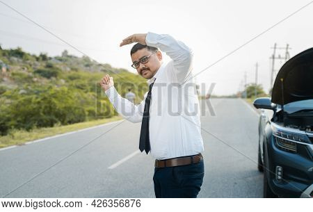 Businessman Asking For Lift Or Hitchhiking Due To Car Breakdown While Traveling - Concept Of Asking
