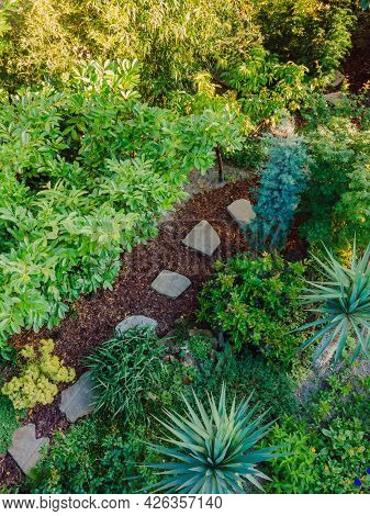 Landscape Design With Flower Beds And Path, Natural Landscaping Panorama In Home Garden. Beautiful V