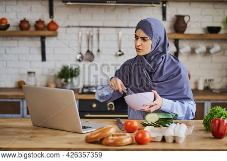 Arabian Woman Watching A Cooking Tutorial And Whipping With A Whisker