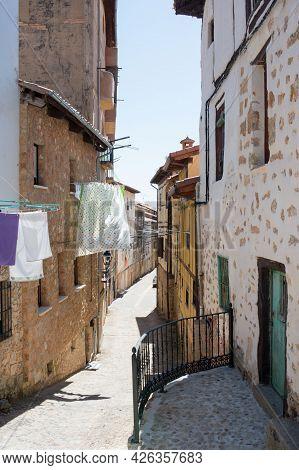 Empty Street At Poza De La Sal, Merindades, Burgos, Spain, Europe. Clothes Drying Under The Sun.