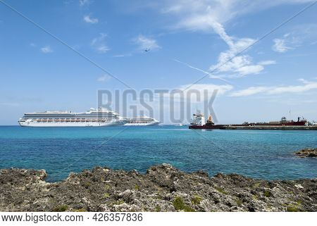 The Helicopter Flying Over Ships In George Town Port On Grand Cayman Island (cayman Islands).