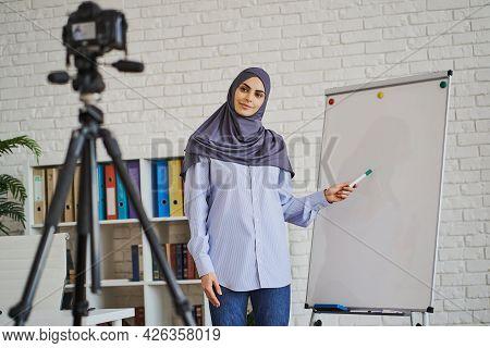 Arabian Business Woman Recording A Video With Her Lecture